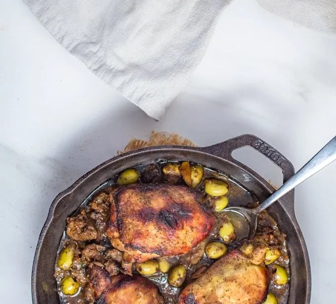 Djaj Mqualli   Moroccan Roasted Lemon & Olives Chicken   Loaded with Citrus, Olives and Creamy Chicken Livers, this Moroccan Rotisserie Style Chicken is a memorable dish to make. #Moroccan #Recipe #Moroccanfood #lemonchicken #tagine