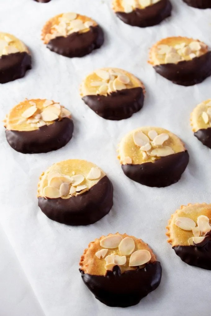 Moroccan Chocolate Dipped Almond Cookies on parchment paper
