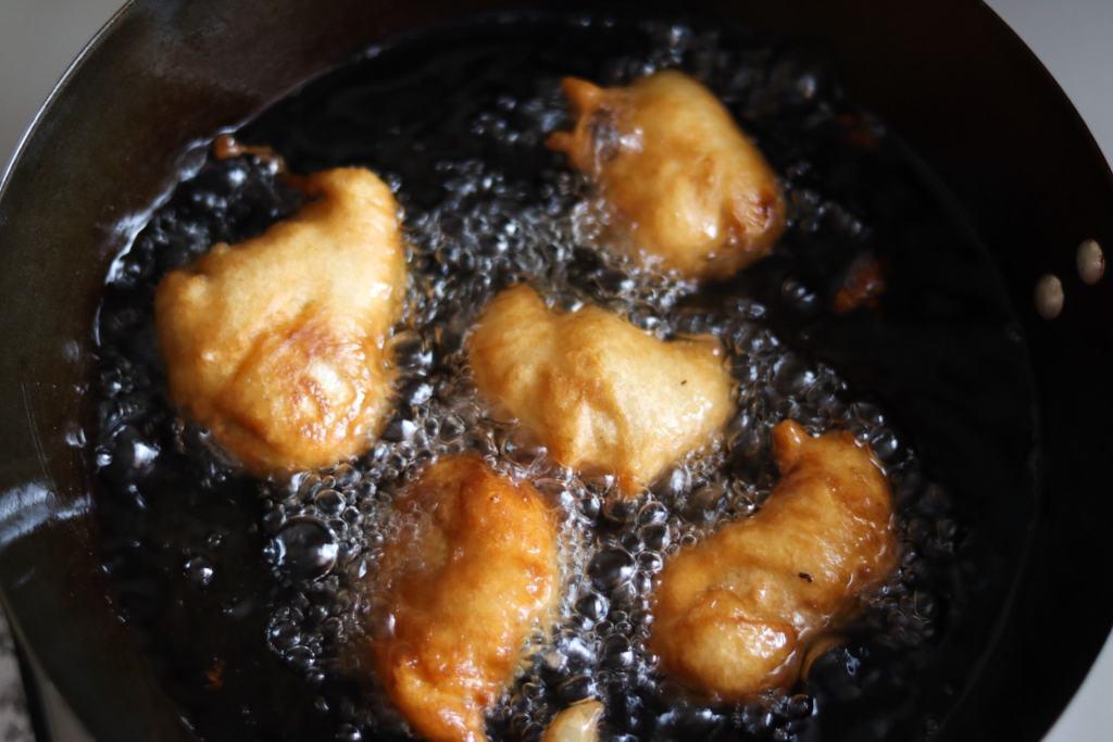 Deep frying the chicken balls.