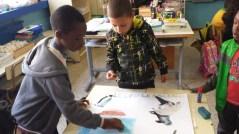 Realizando los murales: Les pôles