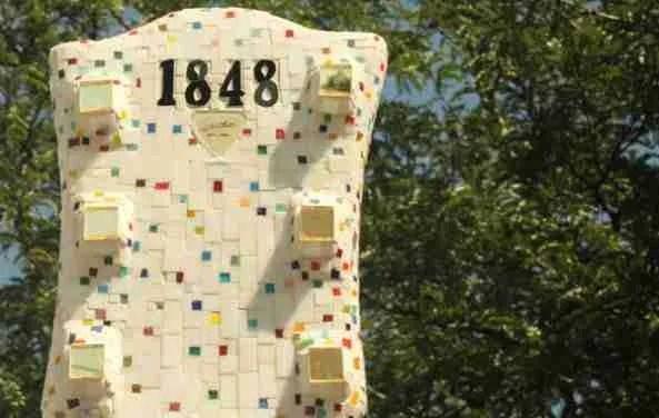 1848 atop the Wisconsin guitar