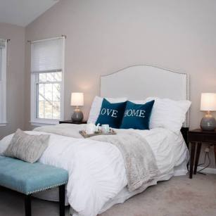 Picture of master bedroom staging using whites and blues