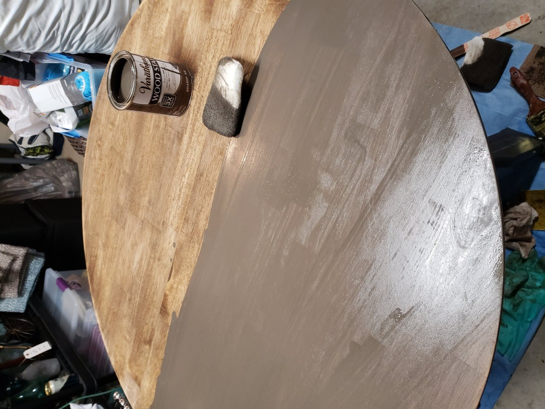 Picture of refinishing a table top with brown stain using staining pads