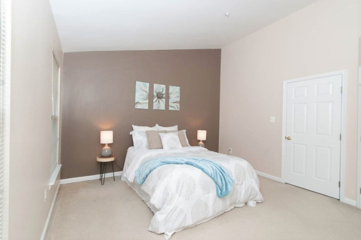 Picture of home staging of a master bedroom of a townhouse