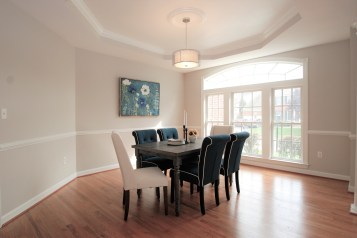 Picture of a staged dining room with blue and cream