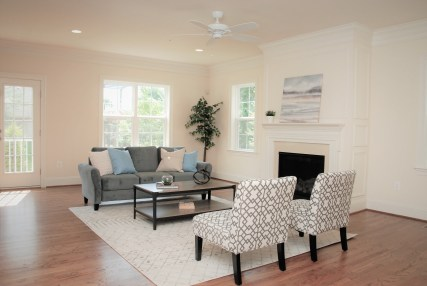 staging of family room for new home builder