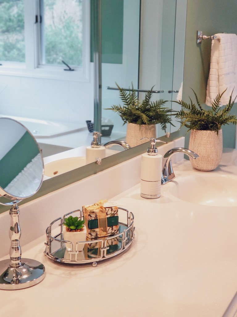 Master bathroom staging details with green colors