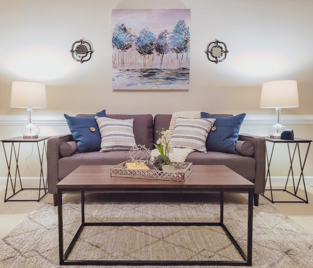 family room staging with mid-century sofa and grays and blues