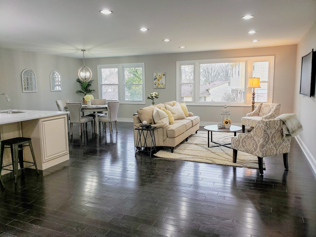 staging an open concept living area with creams and yellow colors