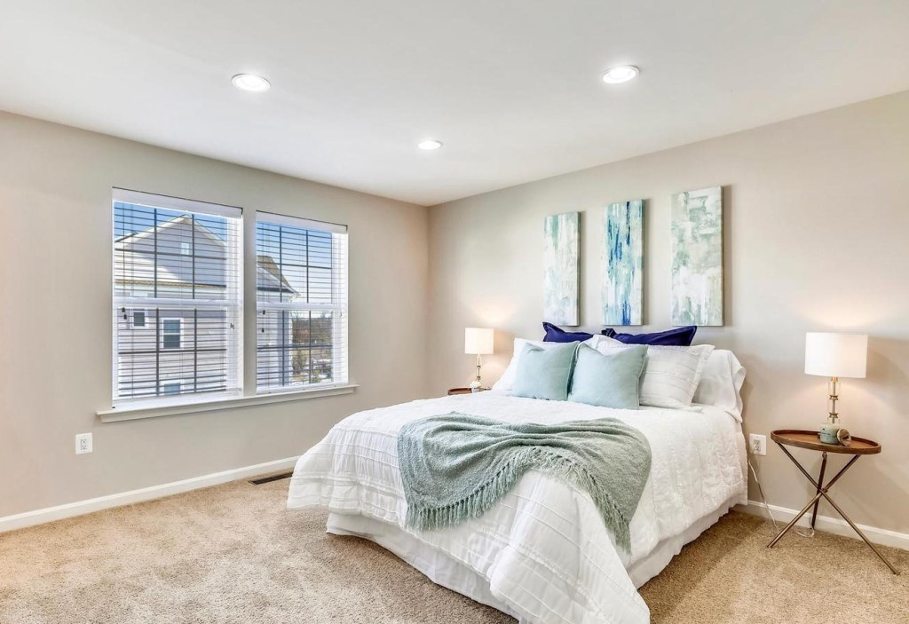 master bedroom with soothing greens and blues