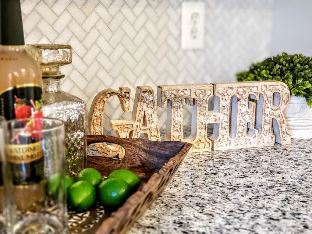 gather sign and bar staging