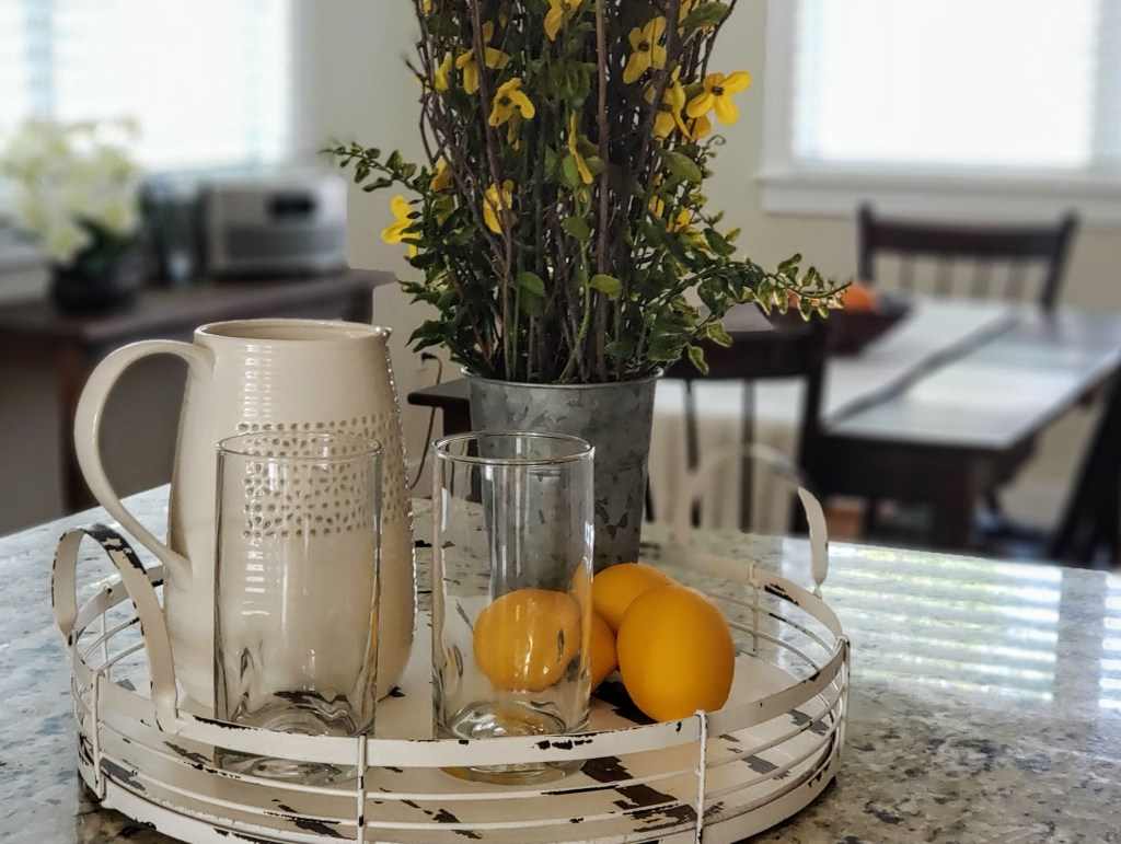 lemonade tray staging with pitcher and flowers