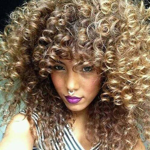 voluminous curly brown hair