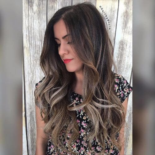 long layered wavy hair with ash blonde highlights