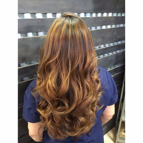 dark chocolate brown hair with caramel highlights