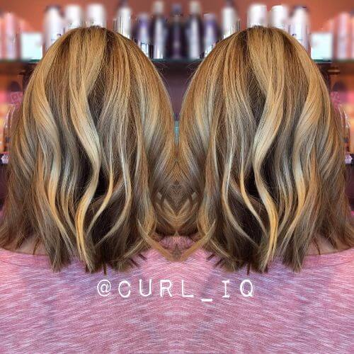 lob haircut on blonde hair with caramel highlights