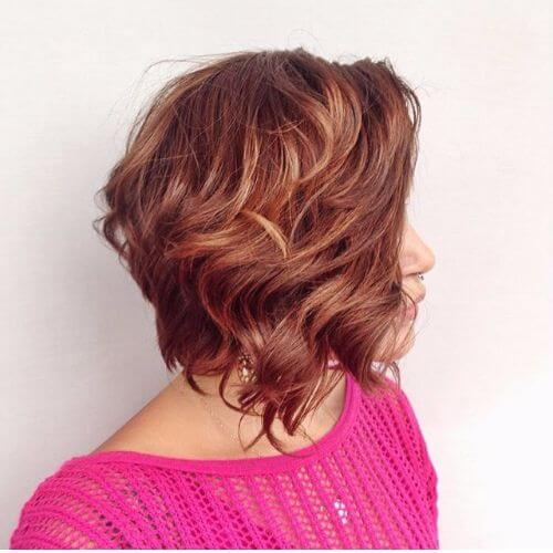 stacked bob hairstyle on copper hair with caramel highlights