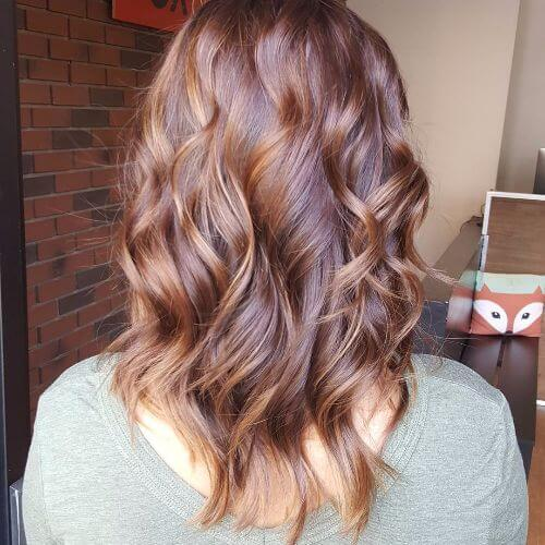 caramel highlights on wavy red hair