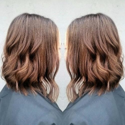 caramel highlights on wavy bob haircut