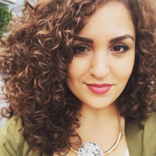 curly hair with caramel highlights
