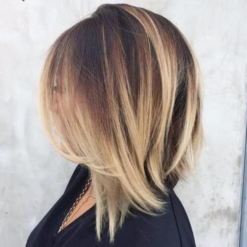 angled dark brown bob haircut