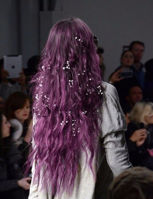 purple hair with small white flower embellishments