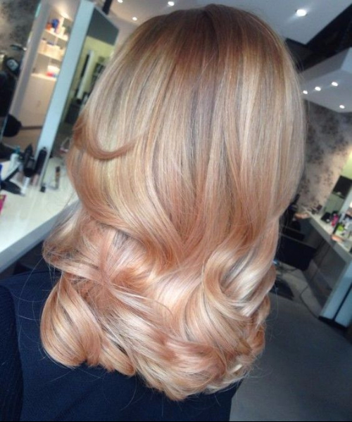 light tangerine and cream balayage hair color