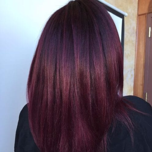 Dark violet base with Merlot color melt balayage plum hair color