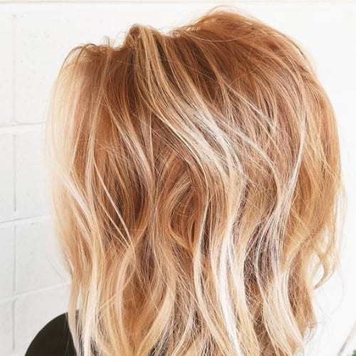Tousled Strawberry Blonde Waves blonde hairstyles