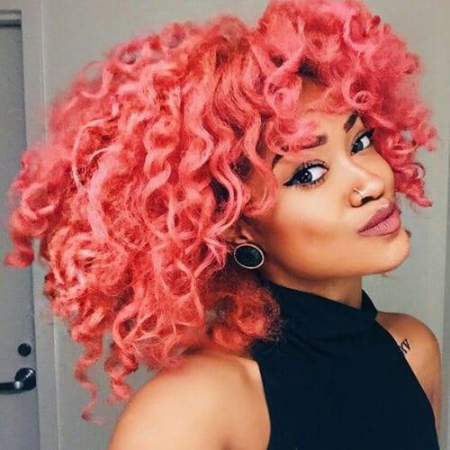 peach curly hair with bangs