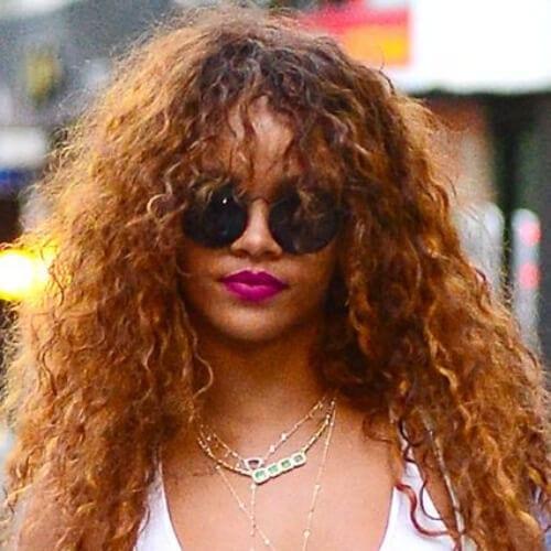 rihanna curly hair with bangs
