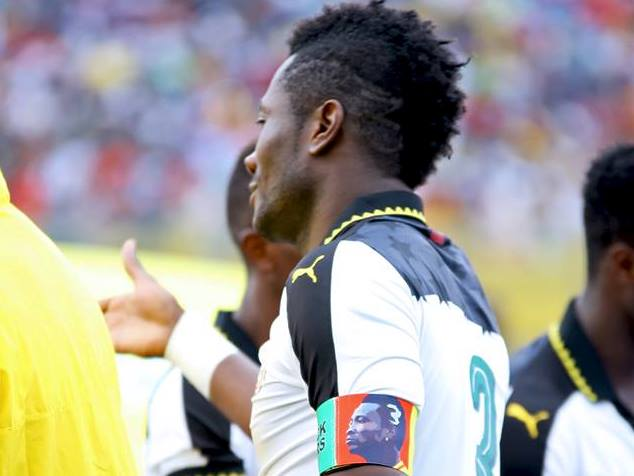Asamoah Gyan slams critics over customized captain's armband