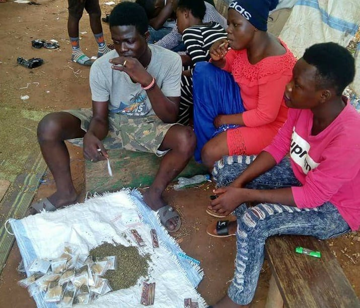 Teenagers in wee Smoking contest at Tamale forest