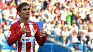Atletico Madrid's French forward Antoine Griezmann celebrates after scoring during the Spanish league football match Club Atletico de Madrid vs Real Sporting de Gijon at the Vicente Calderon stadium in Madrid on September 17, 2016. / AFP / GERARD JULIEN        (Photo credit should read GERARD JULIEN/AFP/Getty Images)