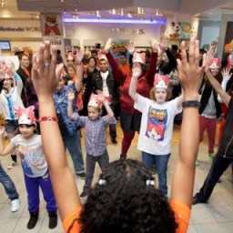 In this photo provided by Nintendo of America, fans of all ages take part in the iconic Yo-kai Dance at the YO-KAI WATCH launch event celebration at Nintendo World on Nov. 7, 2015. YO-KAI WATCH launched on Nov. 6, 2015 and is available exclusively for the Nintendo 3DS family of systems.