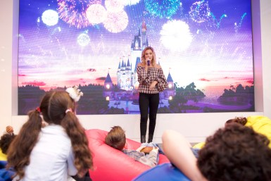 In this photo provided by Nintendo of America, Oliva Holt meets with young fans at the Enchanted Ball Event at Nintendo NY to celebrate the upcoming launch of the game Disney Magical World 2 for the Nintendo 3DS family of systems on Oct. 14.