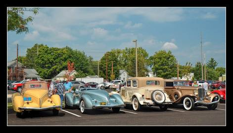 A Row of Classic Auburn Automobiles