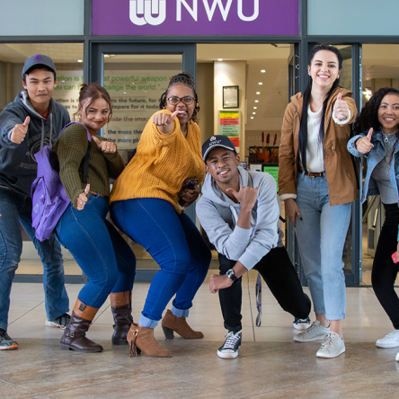 Students posing in front of library
