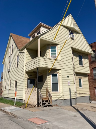 Great example of glorious home modified into a no frills apartment building.