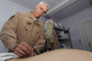 U.S. Air Force Lt. Col. Tim Kaczmar places acupuncture needles into a patient's lower back to relieve muscle tension at Kandahar Airfield, Afghanistan, Aug. 21, 2010. Kaczmar was the surgeon general for the 451st Air Expeditionary Wing. (U.S. Air Force photo by Tech. Sgt. Chad Chisholm/Released)