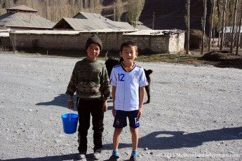 Two Kids with a bucket of Milk posing