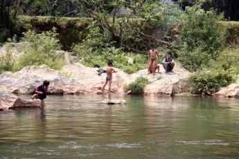 Children spear fishing