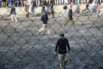 Police chasing the crowd
