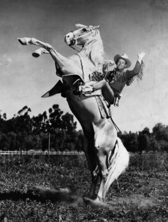 American singing cowboy star Roy Rogers (1911 - 1998), born Leonard Slye riding his horse and longtime co-star Trigger (1932 - 1965). (Photo by Hulton Archive/Getty Images)