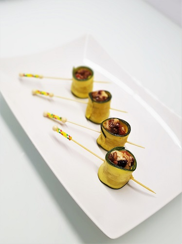 Zucchini and cheese tapas with dried fruits and nuts