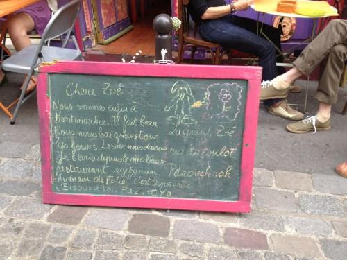 Poem outside Au Grain De Folie Montmartre