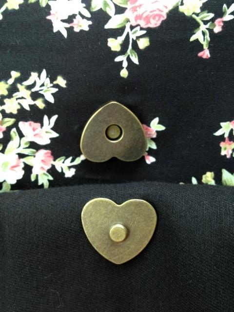 handmade oversized clutch, heart shaped metal magnet clasp
