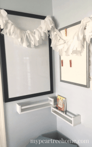 A DIY fabric strip garland is only one of the DIY projects done for this $100 Room Challenge makeover. Click to see the others for playroom inspiration.