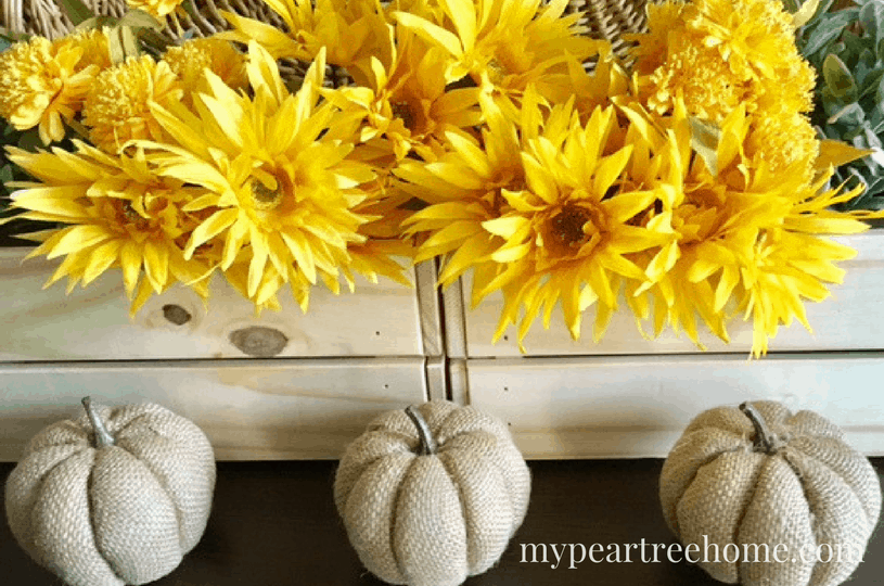 Want to make an easy fall decoration for your home? This banner cost $1 and looks so beautiful! Click to the post to get the printable template to make your own!!