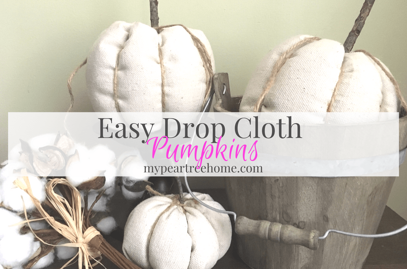 Love the farmhouse look? Click to the post for the tutorial to make these adorable (and EASY) DIY drop cloth pumpkins!